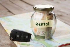 Car rent - money glass, car key and roadmap. Car rent concept - money glass , car key and roadmap Stock Image