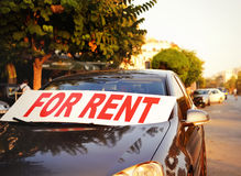 Car for rent in the street. Time for traveling, car rental Stock Photo