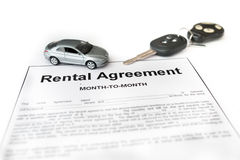 Car rental agreement with car on center Royalty Free Stock Photo