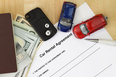Car rental agreement with car key, passport, cash, credit card Royalty Free Stock Photography