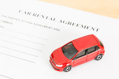 Car Rental Agreement With Red Car at Bottom Right Corner Royalty Free Stock Photography