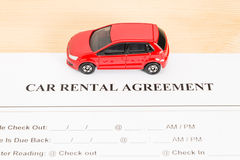 Car Rental Agreement With Red Car on Center Stock Photos
