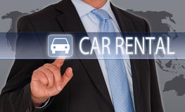 Car rental concept. Businessman with a touchscreen and icon with car and text saying car rental, with world map as background stock photos