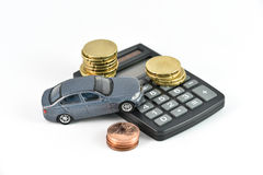 Car rental expences concept. Toy car, calculator and money concept for buying, renting, fuel or service and repair costs Stock Image