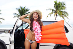 Car rental: happy woman and her car near the beach Royalty Free Stock Photos