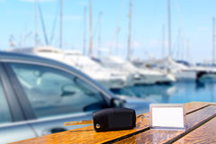 Car rental keys on wood table. With blank paper in vacation boats Mediterranean marina royalty free stock photos