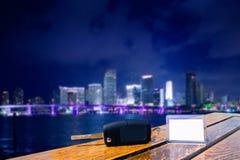 Car rental keys on wood table in Miami night Royalty Free Stock Image