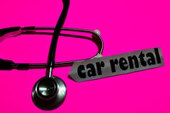 Car Rental plan on the paper with medicare Concept. Inspiration. Stethoscope on pink bakcground stock photos
