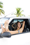 Car rental: woman in car near beach Stock Images
