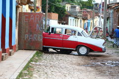 Car repair. Car being repaired in the streets of Trinidad Cuba Stock Image