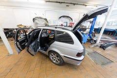 The car is in the repair on car repair Stock Image