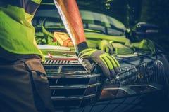 Car Repair Concept. Car Repair Photo Concept. Mechanic Working To Fix Modern Car. Closeup Photo royalty free stock image