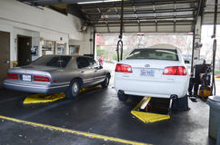 A car repair garage. Two cars inside a repair garage Royalty Free Stock Photo