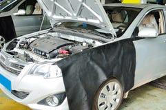 Car for repair in garage Royalty Free Stock Image