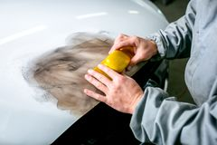 Car repair in car service. Locksmith rushes car detail, hands close up. royalty free stock photo
