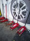 Car repair - tire service, in a row lifts along the wall royalty free stock photos