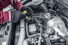 Car repair. Under the hood of the car. Toned photo Royalty Free Stock Image