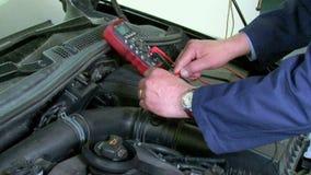 Car Repair Voltmeter Checking stock footage