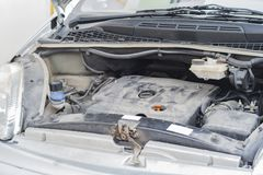 Car repair work in the service station. Car is on repair work in the service station, its hood is open and we can see the details of the car and the engine close stock photos