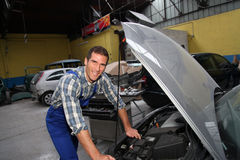 Car repairer at work Royalty Free Stock Photos