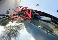 Car repairing battery with jumper cables Stock Images