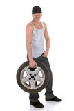 Car repairman with wheel Royalty Free Stock Photography