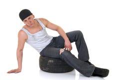 Car repairman with wheel Royalty Free Stock Image