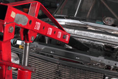 Car repairs. Hydraulic elevator. The automobile hydraulic elevator lifts the repaired car royalty free stock image