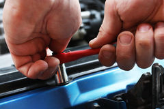 Car repairs by the mechanic Royalty Free Stock Images