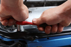 Car repairs by the mechanic Stock Images