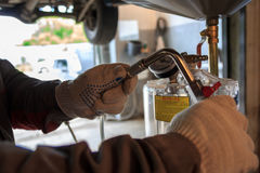 Car repairs. Replacement of oil and liquids Royalty Free Stock Images