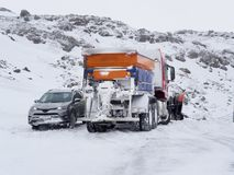 Car rescued by a snowplow. Iceland mountain road in winter royalty free stock photography