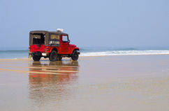 Car of rescuers on the seashore Royalty Free Stock Photos