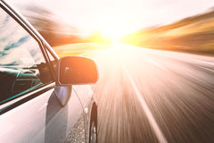 Car ride on road in sunny weather Royalty Free Stock Photo
