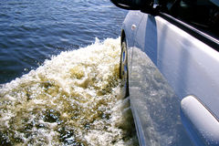 Car rides on big water. Driving on flood road royalty free stock photography