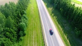 The car rides on a countryside road stock video