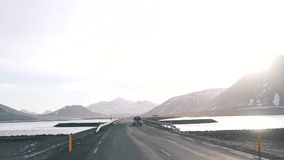 The car rides on an empty road in Iceland.  stock footage