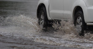 Car rides in heavy rain on a flooded road royalty free stock photo