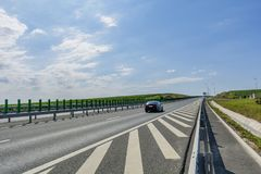 Side view highway on sunny summer day crossing vineyards royalty free stock photo