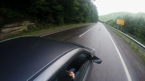 Car rides on a mountain road in the summer stock video footage