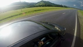 Car rides on a mountain road in the summer stock footage
