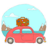 The car rides in the mountains. Red car with a travel suitcase goes among the mountains Royalty Free Stock Photo