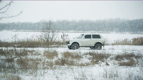 Car rides on winter rural road stock footage