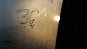 Car riding in the forest, sun shining through the misted glass with painted logo 360 degrees, journey trip adventure stock footage