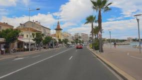 Car riding in resort city street, people walking on embankment, urban life. Stock footage stock video