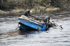 Car in the river. Upsidedown; head over heels Stock Image