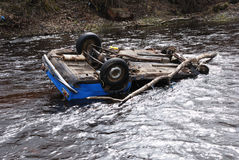 Car in the river. Upsidedown; head over heels Stock Images