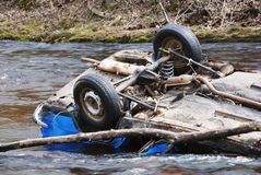 Car in the river. Upsidedown; head over heels Stock Photography
