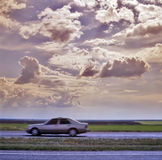 Car on the road. And beautiful sky Royalty Free Stock Photo