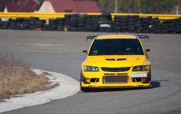 Car on road. Fast sports yellow car on the asphalt road Stock Photos